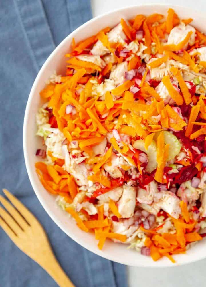 bowl of grated veggies and chicken breast