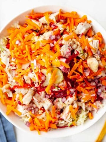 bowl of grated veggies and chopped chicken breast